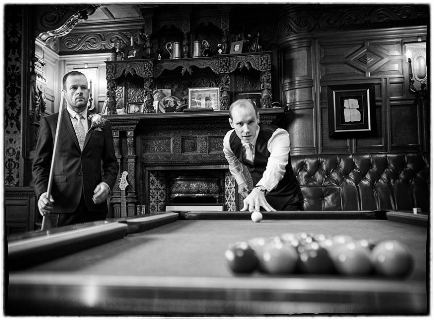 the groom playing pool