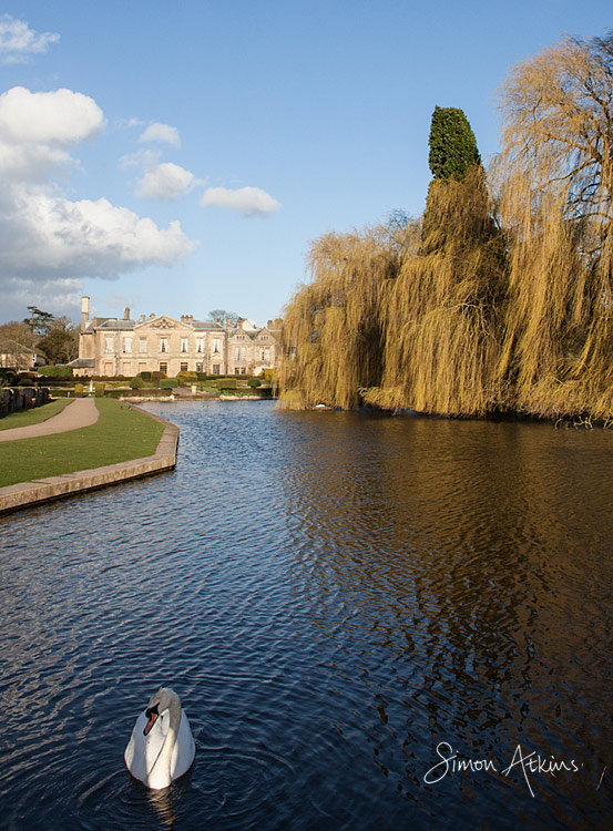 coombe abbey reflected in the lake